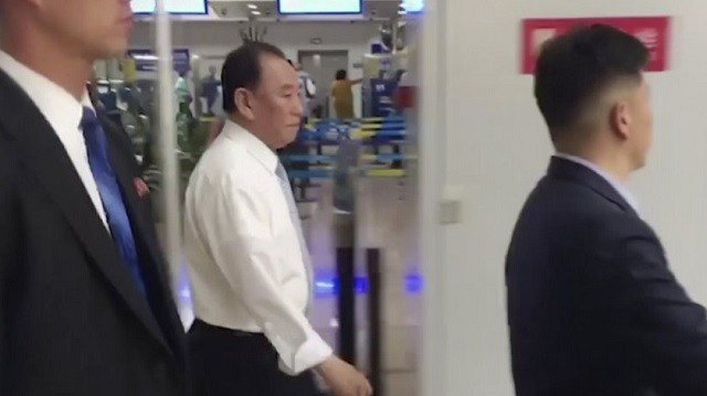 In this image made from video, Kim Yong Chol, center , a former military intelligence chief who is now Kim Jong Un's top official on inter-Korean relations, walks upon arrival at Beijing airport in Beijing Tuesday, May 29, 2018. (AP Photo)
