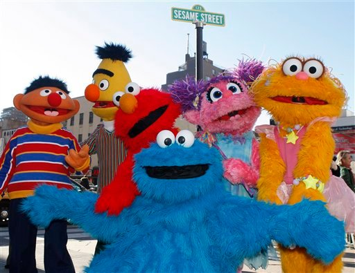 Characters from Sesame Street Live appear on the street by Madison Square Garden to celebrate the 30th anniversary of the live touring stage shows based on the PBS television series in New York, Thursday, Feb. 4, 2010.