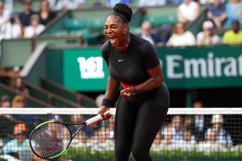 Serena Williams clenches her fist after scoring a point against Krystina Pliskova of the Czech Republic during their first round match of the French Open tennis tournament at the Roland Garros stadium in Paris, France. (AP Photo/Alessandra Tarantino)