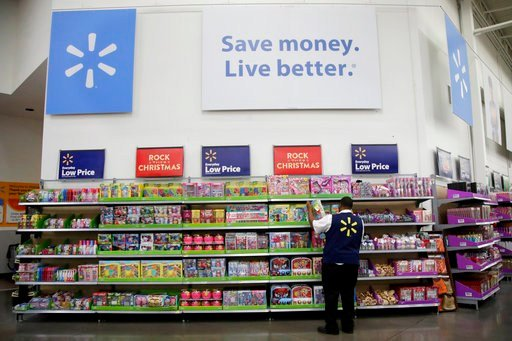 FILE- In this Nov. 9, 2017, file photo, a Walmart employee scans items while conducting an exercise during a Walmart Academy class session at the store in North Bergen, N.J. (AP Photo/Julio Cortez, File)