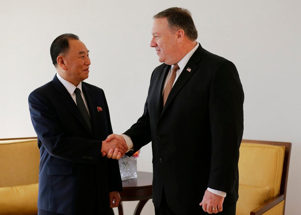 Kim Yong Chol, left, former North Korean military intelligence chief and one of leader Kim Jong Un's closest aides, shakes hands with U.S. Secretary of State Mike Pompeo during a meeting, Thursday, May 31, 2018, in New York. (AP Photo/Seth Wenig)