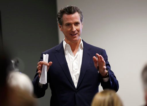 FILE - In this May 25, 2018, file photo, California gubernatorial candidate Lt. Gov. Gavin Newsom speaks during a visit with veterans and their families in San Diego. (AP Photo/Gregory Bull, File)
