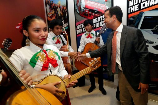 In this Tuesday, May 29, 2018 photo, Rep. Carlos Curbelo, R-Fla., shakes hands with band members while attending the 34th Annual Farmworker Student Recognition Ceremony in Homestead, Fla. (AP Photo/Lynne Sladky)