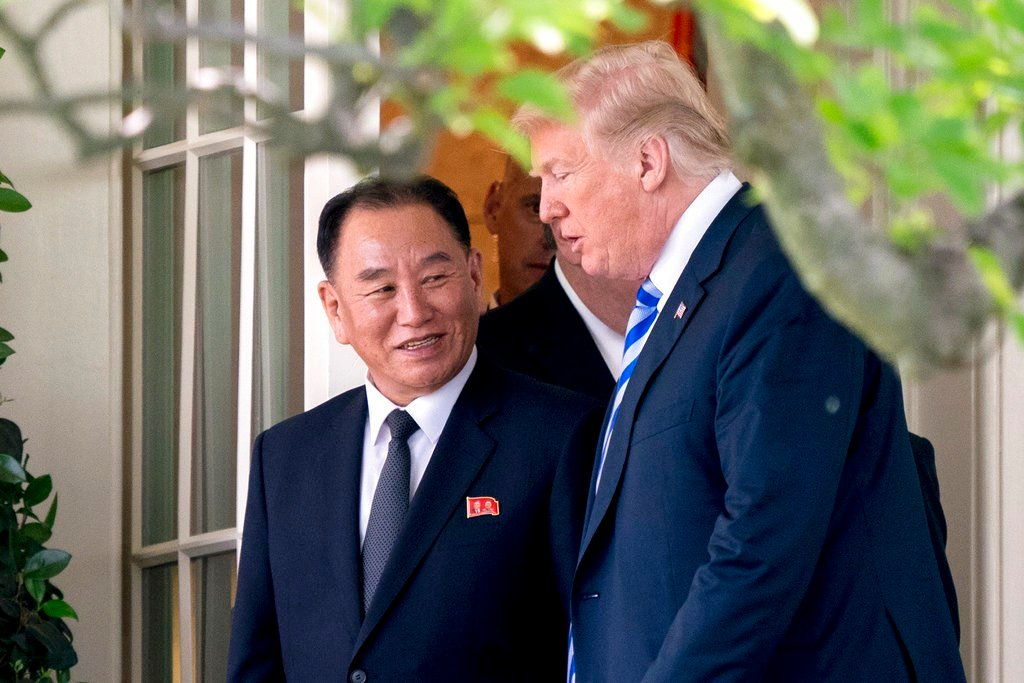 President Donald Trump talks with Kim Yong Chol, former North Korean military intelligence chief and one of leader Kim Jong Un's closest aides, as they walk from their meeting in the Oval Office of the White House. (AP Photo/Andrew Harnik)