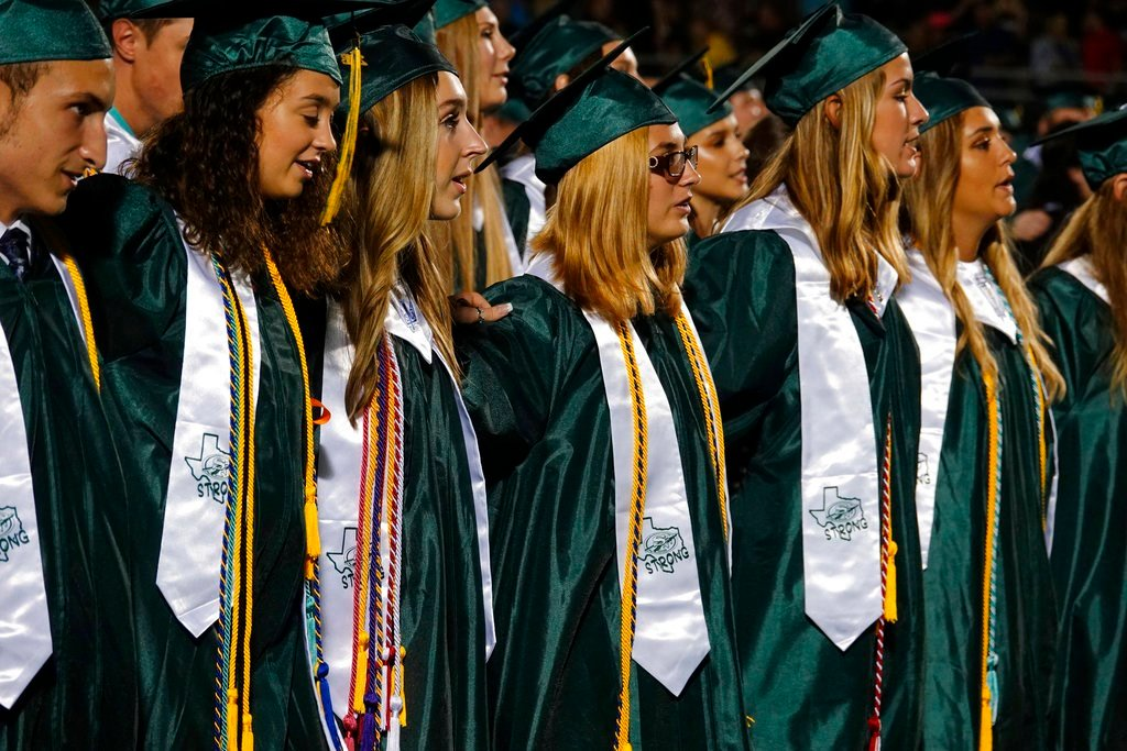 Students attend the Santa Fe High School graduation ceremony Friday, June 1, 2018, in Santa Fe, Texas. (Chelsey Cox/Santa Fe Independent School District via AP)