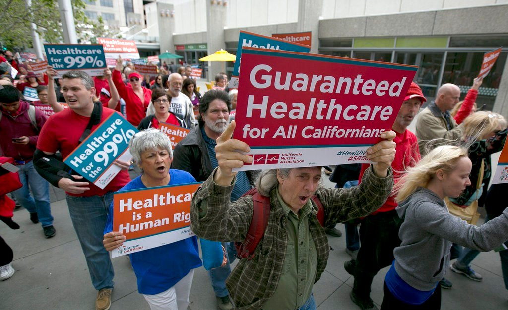 FILE - In this April 26, 2017 file photo supporters of single-payer health care march to the Capitol in Sacramento, Calif. Health care is one of the sticking points between the major gubernatorial candidates in the June primary.(AP Photo/Rich Pedroncelli)