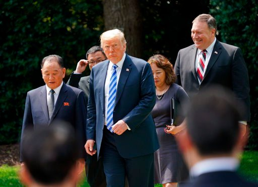 President Donald Trump walks with Kim Yong Chol, left, former North Korean military intelligence chief and one of leader Kim Jong Un's closest aides, after their meeting in the Oval Office of the White House in Washington, Friday, June 1, 2018, as Secreta