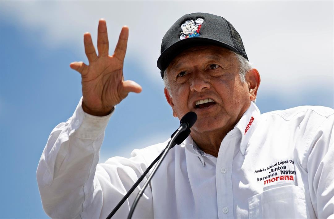 Presidential candidate Andres Manuel Lopez Obrador, known as AMLO, speaks to supporters at a campaign rally in Mexico City, Sunday, June 3, 2018. Mexico will hold general elections on July 1. (AP Photo/Anthony Vazquez)
