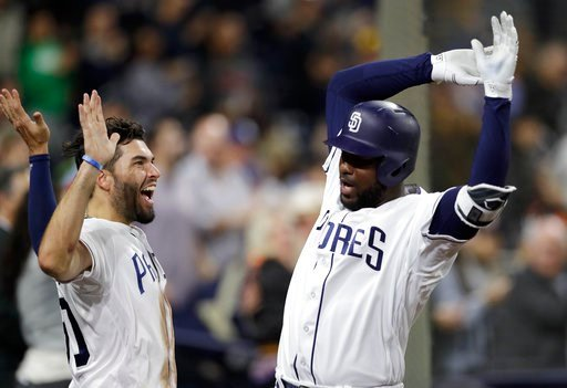 an Diego Padres' Franmil Reyes, right, celebrates with teammate Eric Hosmer, left, after hitting a home run during the sixth inning of a baseball game against the Atlanta Braves Monday, June 4, 2018, in San Diego. (AP Photo/Gregory Bull)