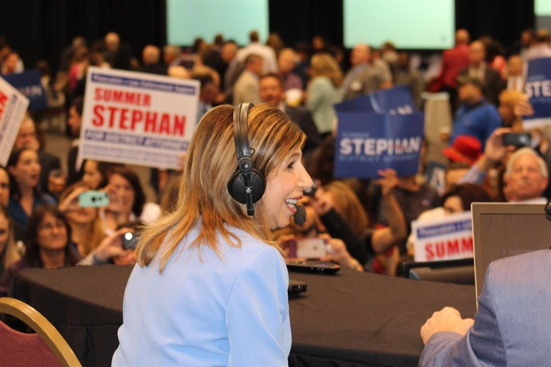 Interim District Attorney Summer Stephan being interviewed by AM 760 hosts on election night.