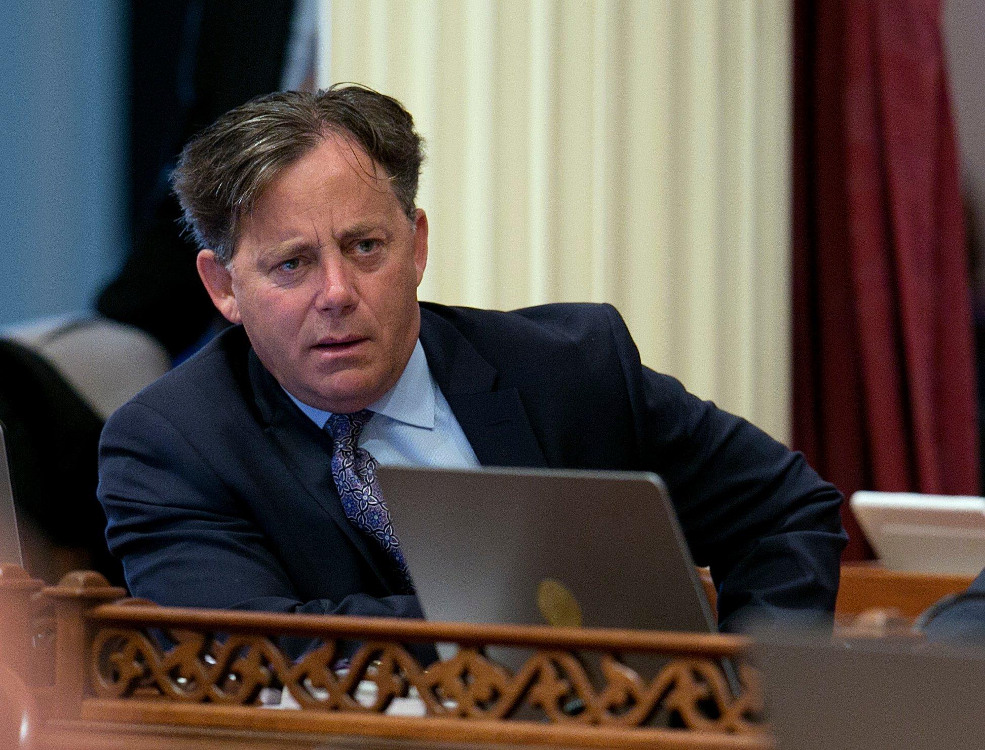 State Sen. Josh Newman, D-Fullerton, left, listens as lawmakers debate a recall election measure. (AP Photo/Rich Pedroncelli)