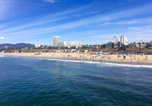 In this photo taken March 18, 2018, the ocean and beach are viewed from the pier in Santa Monica, Calif.  (AP Photo/John Antczak)