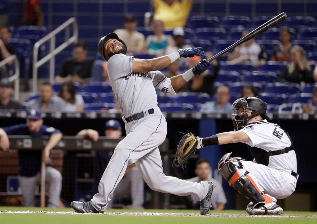 San Diego Padres' Manuel Margot, left strikes out during the seventh inning of a baseball game against the Miami Marlins, Friday, June 8, 2018, in Miami. (AP Photo/Lynne Sladky)