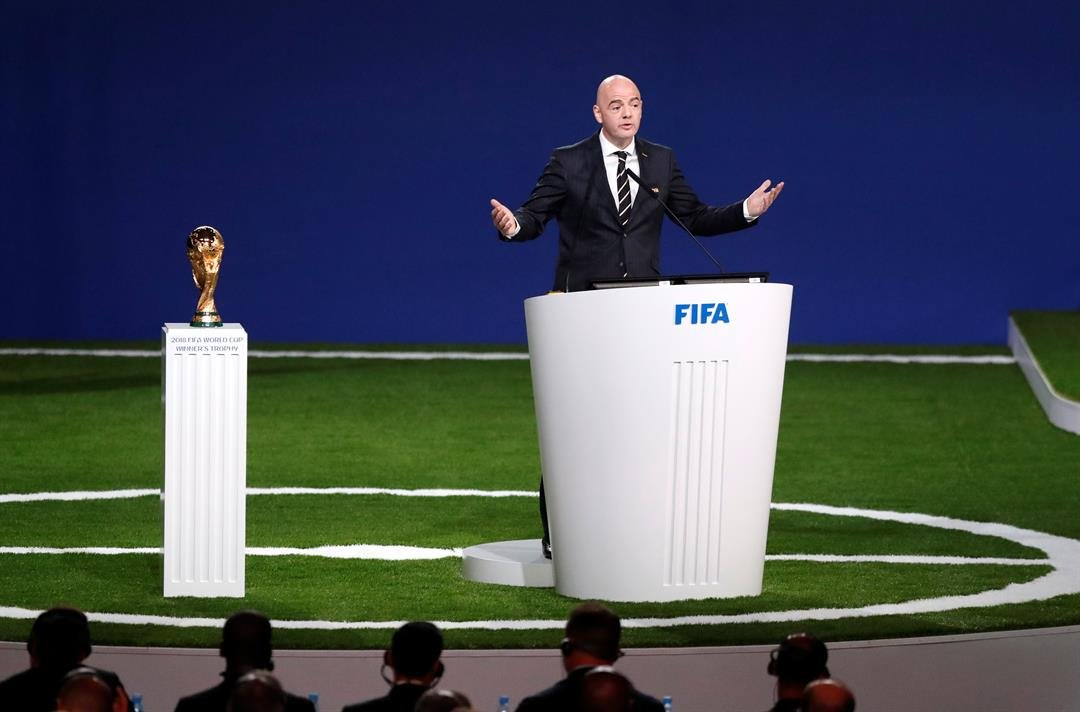FIFA President Gianni Infantino delivers a speech beside World Cup trophy at the FIFA congress on the eve of the opener of the 2018 soccer World Cup.  (AP Photo/Pavel Golovkin)