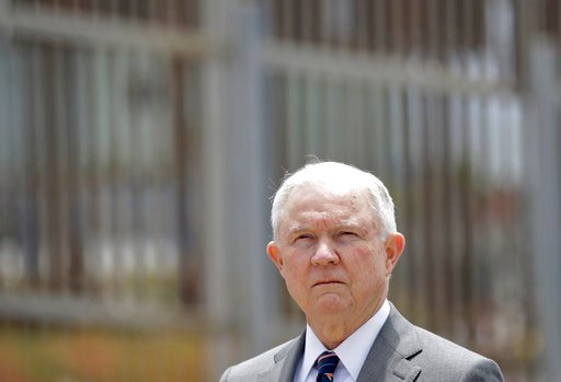 FILE - In this May 7, 2018, file photo, Attorney General Jeff Sessions listens during a news conference in San Diego near the border with Tijuana, Mexico. (AP Photo/Gregory Bull, File)