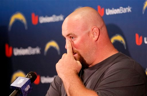 San Diego Chargers offensive lineman Chris Dielman wipes away tears during a news news conference where he announced his retirement from NFL football, Thursday, March 1, 2012 in San Diego.