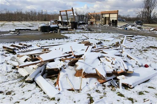 Snow covers the ground, Monday, March 5, 2012, in Mt. Olive, Ohio, around what remains of a home in which a man was killed when a tornado came through the area Friday. (AP Photo/Al Behrman)