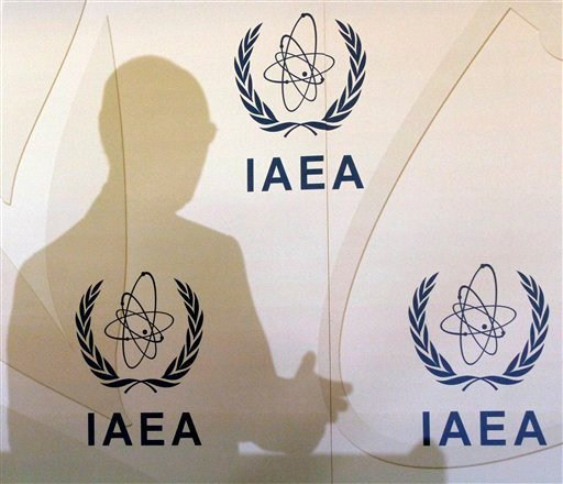 Director General of the International Atomic Energy Agency, IAEA, Yukiya Amano of Japan casts a shadow on the wall during a news conference after a meeting of the IAEA's board of governors at the International Center, in Vienna, Austria, March 5, 2012.