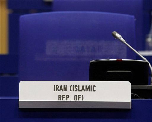 The armchair of Iran's Ambassador to the International Atomic Energy Agency, IAEA, Ali Asghar Soltanieh remains empty at the start of the IAEA board of governors meeting at the International Center, in Vienna, Austria, on Tuesday, March 6, 2012.