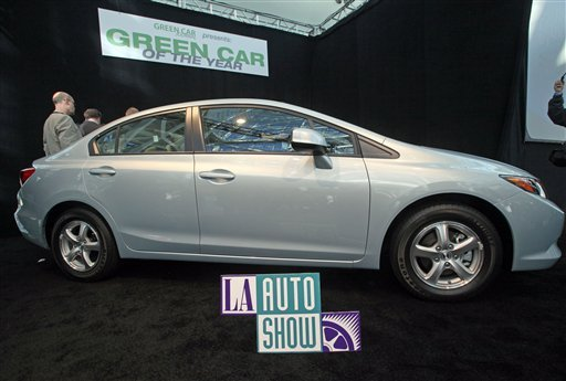 FILE - In this Nov. 17, 2011 file photo, the 2012 Honda Civic Natural Gas car, named Green Car of the Year for 2012, is displayed after its unveiling at press preview day for the Los Angeles Auto Show.