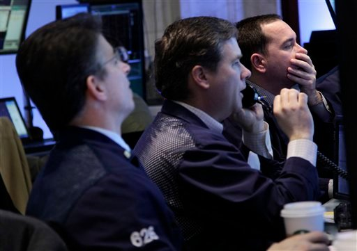 In this March 6, 2012 photo, traders work on the floor at the New York Stock Exchange in New York. (AP Photo/Seth Wenig)