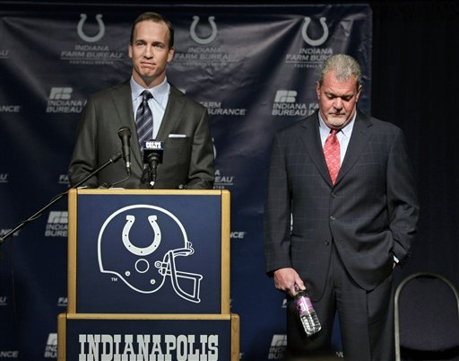 Indianapolis Colts owner Jim Irsay, right, listens as quarterback Peyton Manning speaks during a news conference in Indianapolis, Wednesday, March 7, 2012. (AP Photo/Michael Conroy)