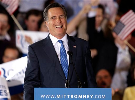 Republican presidential candidate, former Massachusetts Gov. Mitt Romney smiles as he addresses supporters at his Super Tuesday campaign rally in Boston, Tuesday, March 6, 2012. (AP Photo/Stephan Savoia)
