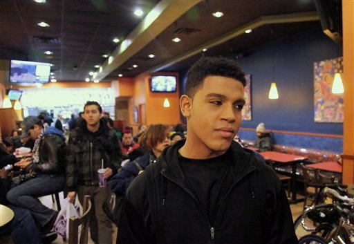 Baresco Escobar, 19, from Fairfax, Va., an aspiring entertainer who identifies himself as bisexual, visits a local fast food hangout in Manhattan's Union Square popular with youth from the LGBT.  (AP Photo/Bebeto Matthews)