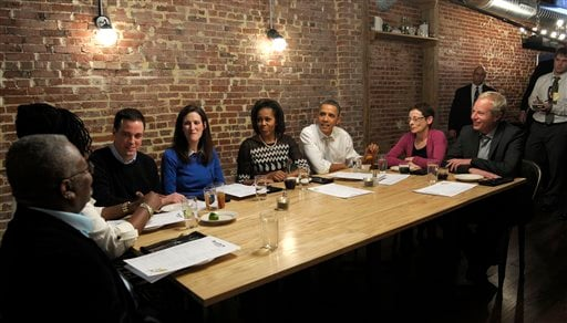 President Barack Obama and first lady Michelle Obama have dinner with grassroots supporters at Boundary Road Restaurant in Washington. (AP Photo/Susan Walsh)