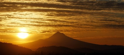 The sun rises over Mount Hood in Portland, Ore. on Thursday, March 8, 2012.
