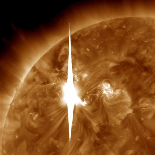 This handout image provided by NASA shows a solar flare errupting at 7 p.m. EDT on Tuesday, March 6, 2012, and that is heading toward Earth.
