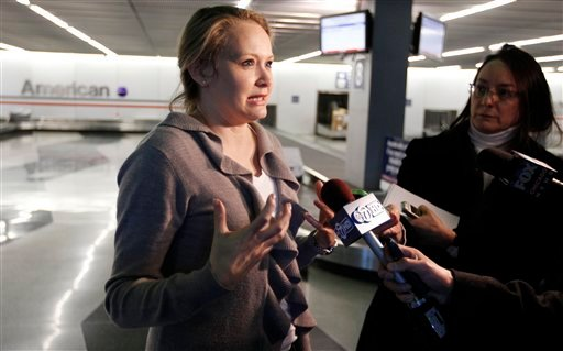 Bethany Christakos, a passenger on an American Airlines flight from Dallas to Chicago, talks to reporters upon landing in Chicago, after the the flight was disrupted when a flight attendant ranted about the plane crashing, on Friday, March 9, 2012. (AP)