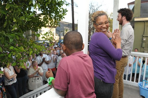In this March 1, 2012, file photo homeowner Mary Jones celebrates with her 10-year-old son Paul Williams during a dedication for their newly renovated home in New Orleans. (AP)