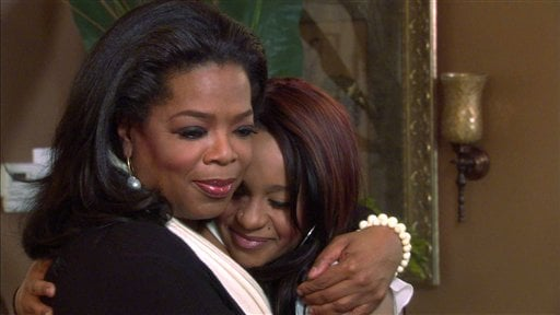 In this undated image from video released by Harpo, Inc., host Oprah Winfrey, left, embraces Bobbi Kristina, daughter of the late singer Whitney Houston during an interview in Atlanta, Ga.