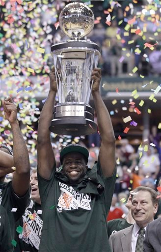 Michigan State forward Draymond Green holds up the Big Ten trophy after an NCAA college basketball game against Ohio State in the final of the conference's men's tournament in Indianapolis March 11, 2012. (AP Photo/Michael Conroy)