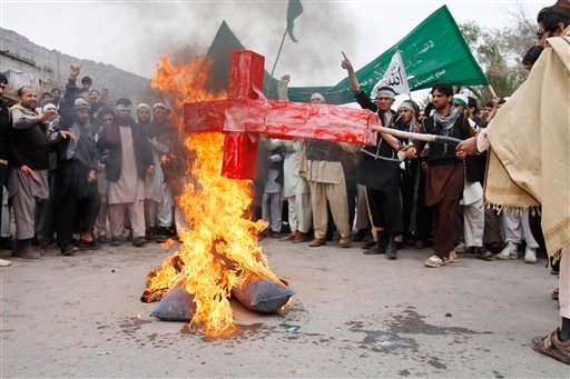 Afghans burn an effigy depicting U.S. President Barack Obama following Sunday's killing of civilians in Panjwai, Kandahar by a U.S. soldier during a protest in Jalalabad east of Kabul, Afghanistan, Tuesday, March 13, 2012. (AP)