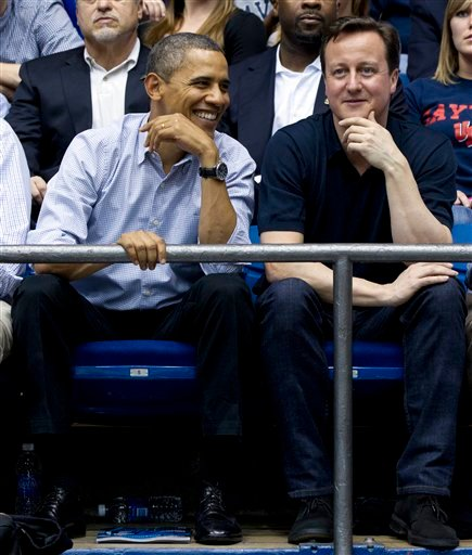 President Barack Obama and Britain's Prime Minister David Cameron attend the Mississippi Valley State versus Western Kentucky in a first round NCAA tournament game March 13, 2012, at University of Dayton Arena, in Dayton, Ohio. (AP Photo/Carolyn Kaster)
