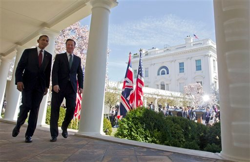 President Barack Obama and British Prime Minister David Cameron walk back toward the Oval Office of the White House in Washington, Wednesday, March 14, 2012, after their joint news conference in the Rose Garden. (AP Photo/Pablo Martinez Monsivais)