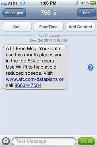 FILE - This undated file screen grab provided by Mike Trang shows a warning message on the screen of his iPhone that he received from AT&T advising he was in danger of having his data speeds throttled. (AP Photo/courtesy of Mike Trang, File)
