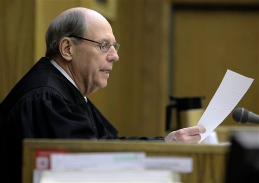 Presiding Judge William Alexander reads instructions to the jury in Montgomery County Circuit Court in Christiansburg Va. on Wednesday March 14 2012.