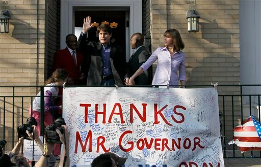 Former Illinois Gov. Rod Blagojevich walks out of his home with his wife Patti to speak to the media Wednesday, March 14, 2012 in Chicago.