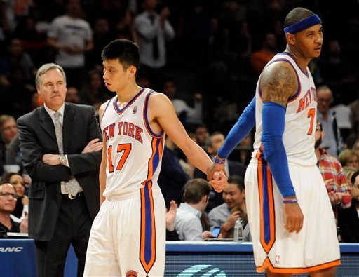 Feb. 20, 2012 file photo: New York Knicks' Carmelo Anthony, right, holds Jeremy Lin's hand as he leaves the game after fouling out during the fourth quarter of an NBA basketball game against the New Jersey Nets. (AP Photo/Bill Kostroun, File)