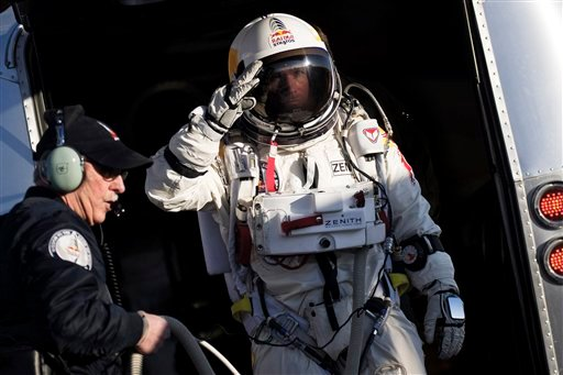 In this photo provided by Red Bull Stratos, Felix Baumgartner salutes as he prepares to board the capsule carried by a balloon during the first manned test flight for Red Bull Stratos in Roswell, N.M. on Thursday, March 15, 2012.