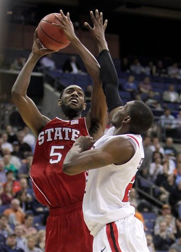 North Carolina State's C.J. Leslie, left, shoots over San Diego State's Deshawn Stephens during the second half of an NCAA college basketball tournament second-round game.
