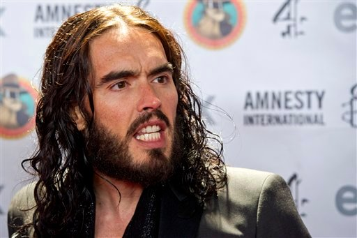 """FILE - In this March 4, 2012 file photo, Russell Brand arrives to Amnesty International's """"Secret Policeman's Ball"""" in New York. New Orleans police have issued an arrest warrant for actor Russell Brand."""