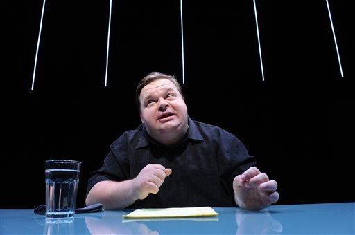 "In this undated image released by The Public Theater, Mike Daisey is shown in a scene from ""The Agony and The Ecstasy of Steve Jobs,"" in New York. Daisey, whose latest show has been being credited with sparking probes into how Apple's high-tech devices.."