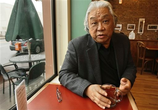 In this file photo taken Jan. 20, 2011, Glenn Nishimura discusses his health insurance situation at a coffee shop in Little Rock, Ark. (AP)