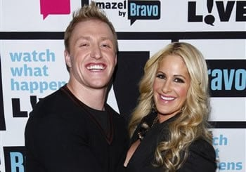 "FILE - In this Jan. 29, 2012 file image released by Bravo, Kroy Biermann, left, and Kim Zolciak pose backstage after Bravo's ""Watch What Happens Live"" show in New York. (AP Photo/Bravo, Peter Kramer)"