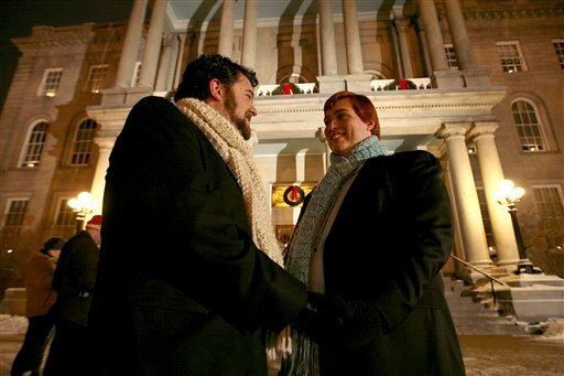 In this Jan. 1, 2010 file photo, Bill Gaudet, left, and Ramon Gaudet, right, wait to be wed in front of New Hampshire's Statehouse in Concord, N.H. (AP Photo/Cheryl Senter, File)