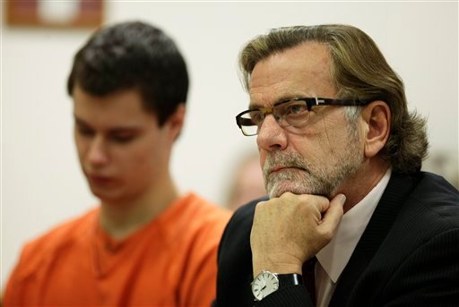 "In this Dec. 16, 2011 photo, John Henry Browne, right, the attorney for Colton Harris-Moore, left, who is also known as the ""Barefoot Bandit,"" sits in Island County Superior Court in Coupeville, Wash. (AP Photo/Ted S. Warren)"